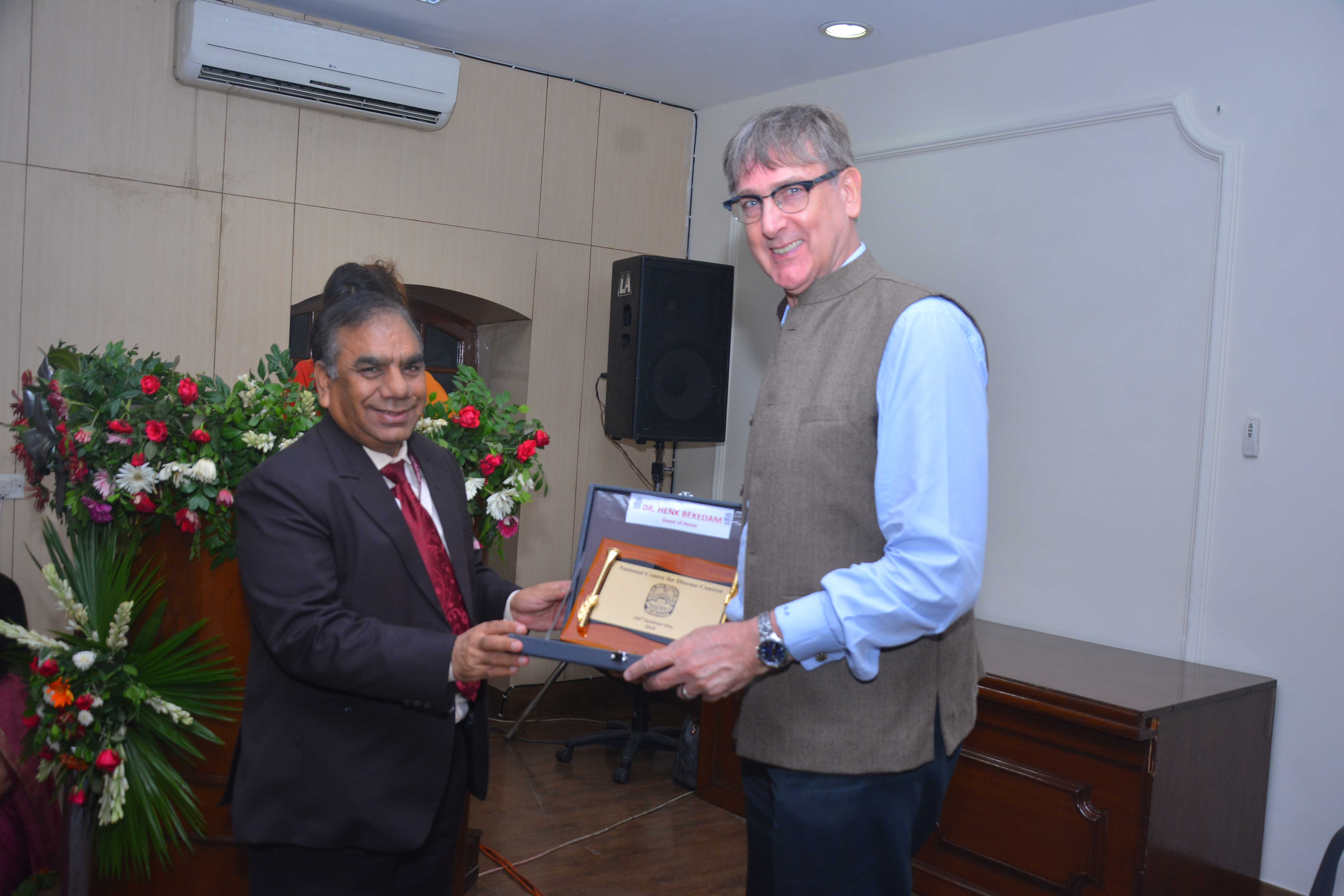 Dr S K Singh, Director(NCDC) presenting memento to Dr Henk Bekedam,WHO Representative India